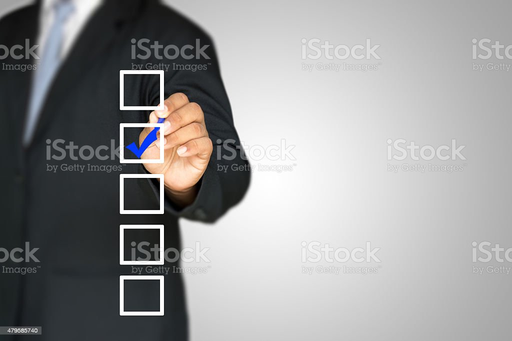 checklist with businessman stock photo