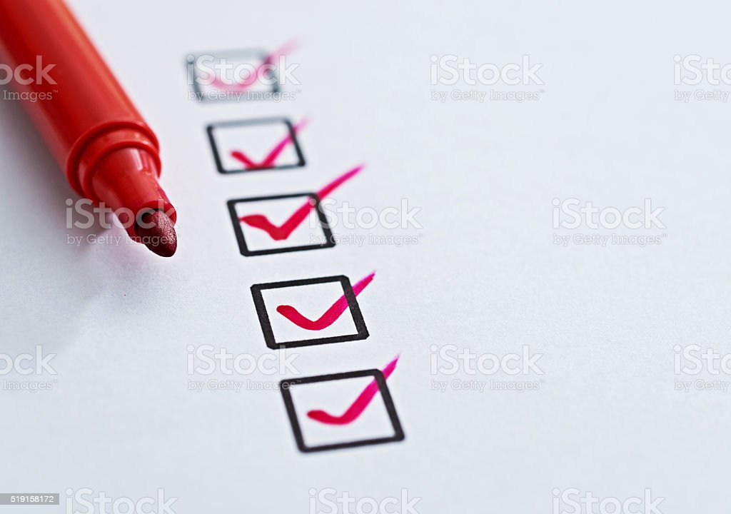 Checklist with check mark stock photo
