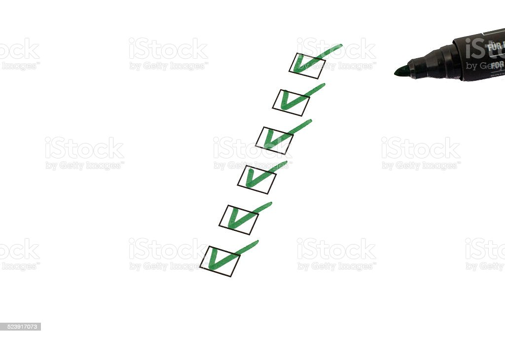 checklist with marker on white background stock photo