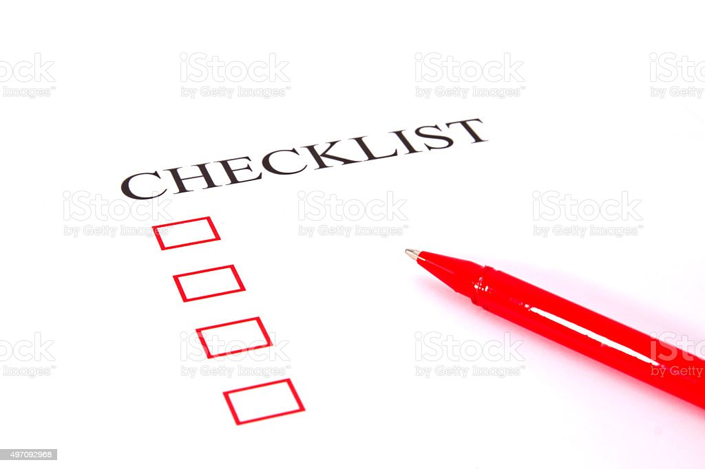 Checklist with pen and checked boxes. stock photo