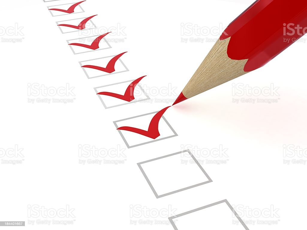 Checklist with red pencil and marks stock photo