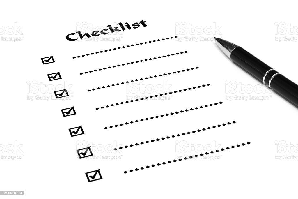 Checkliste mit Kugelschreiber stock photo