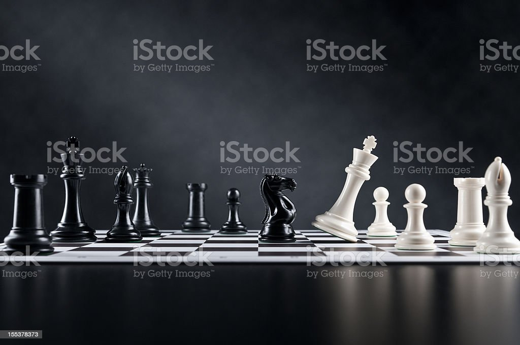 Checkmate move, Chess Knight is checking Chess King, chess board stock photo