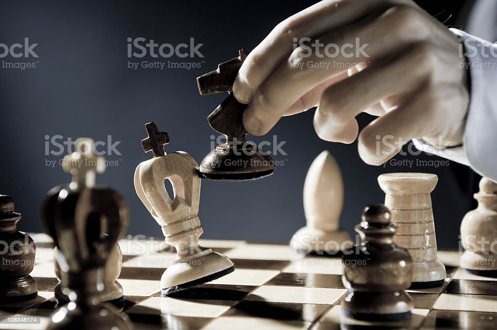 Checkmate Strategy, close-up of chess player, businessman making checkmate move royalty-free stock photo
