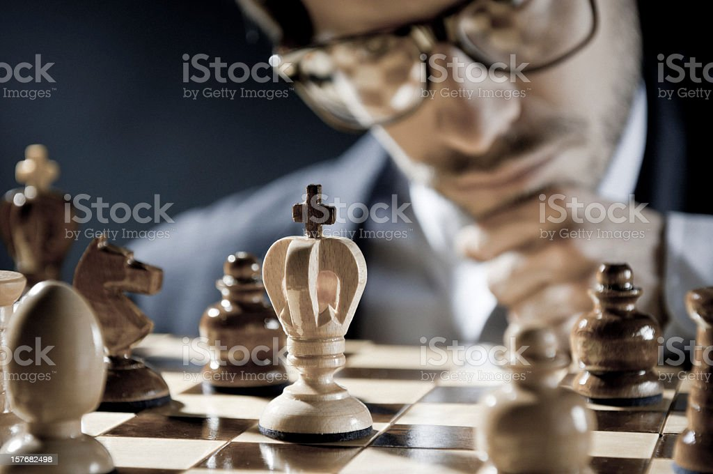 Checkmate strategy, close-up of chess player thinking about next move stock photo