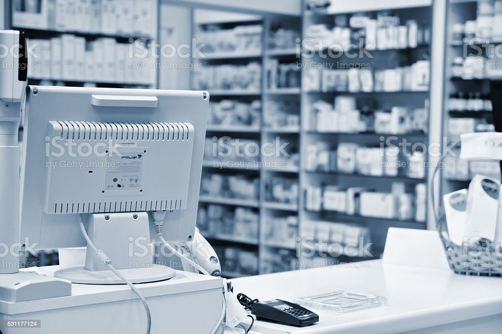 Checkout the pharmacy. Interior pharmacies and blurred background. stock photo