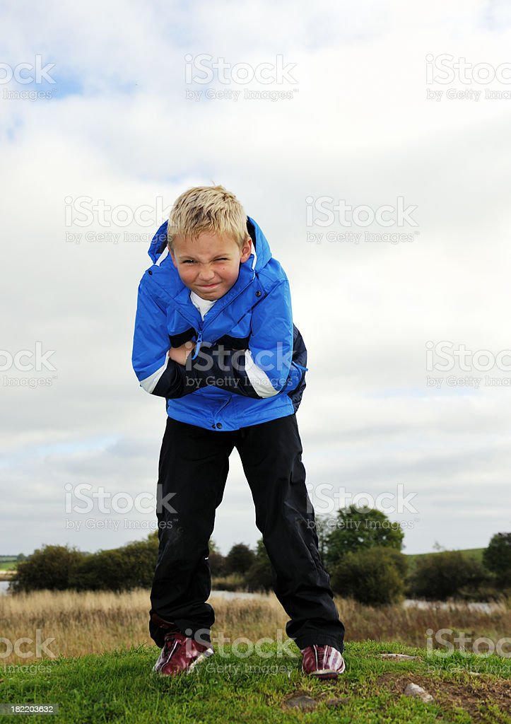 checky little boy with folded arms looking at the camera royalty-free stock photo