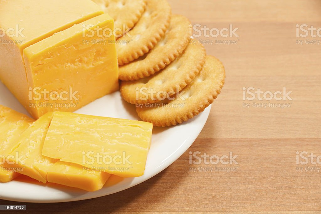Cheddar Cheese and Crackers on Plate stock photo