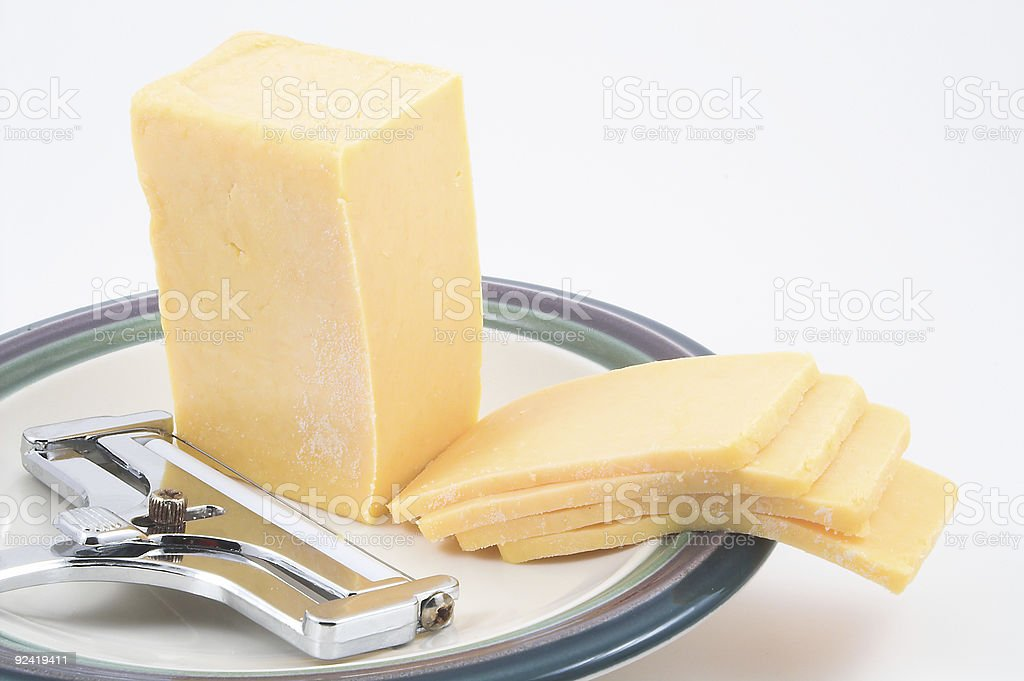 Cheddar Cheese and  Slicer royalty-free stock photo