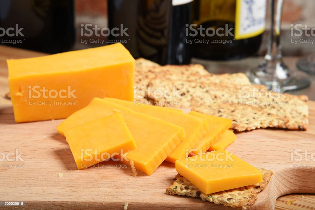 Cheddar cheese and wine stock photo