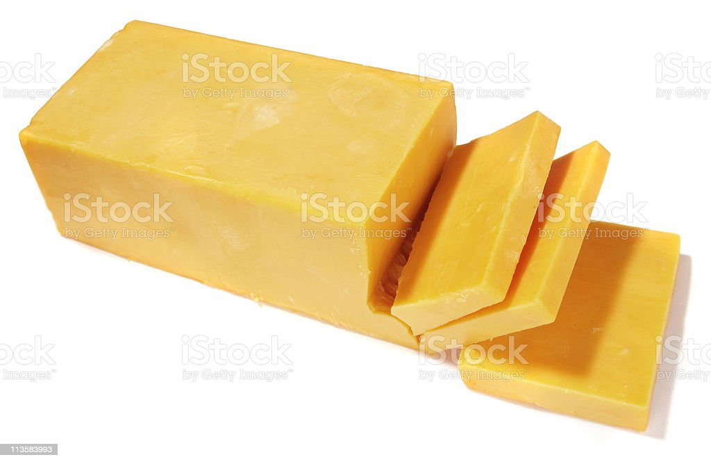 Cheddar cheese being cut on white background stock photo