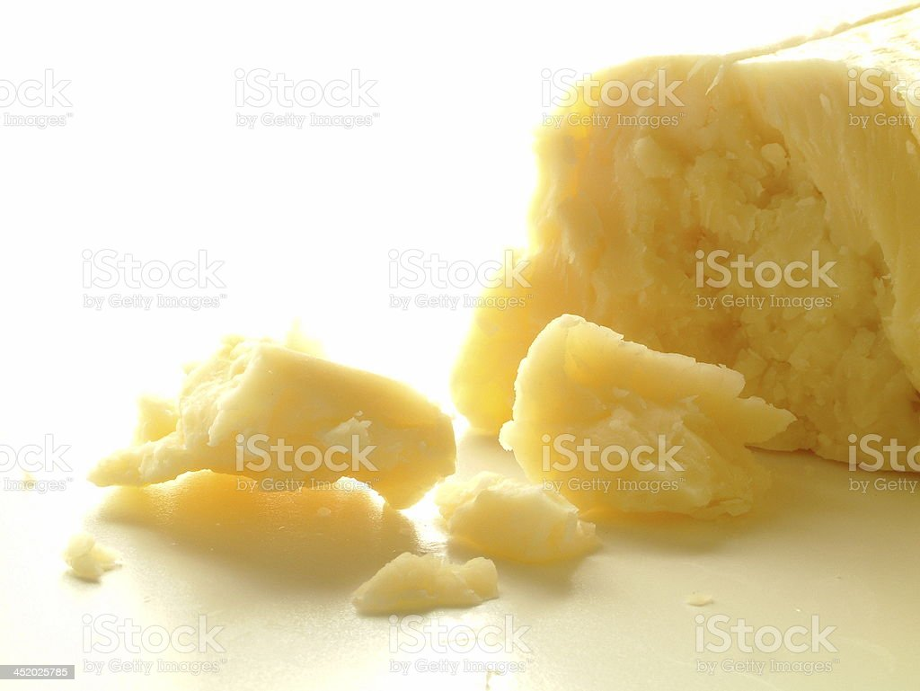 cheddar cheese block on white background stock photo
