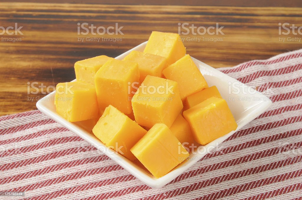 Cheddar cheese cubes stock photo