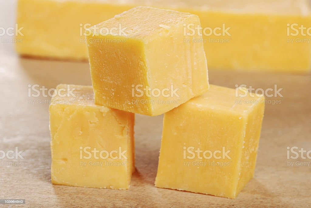 cheddar cheese cubes shallow DOF royalty-free stock photo