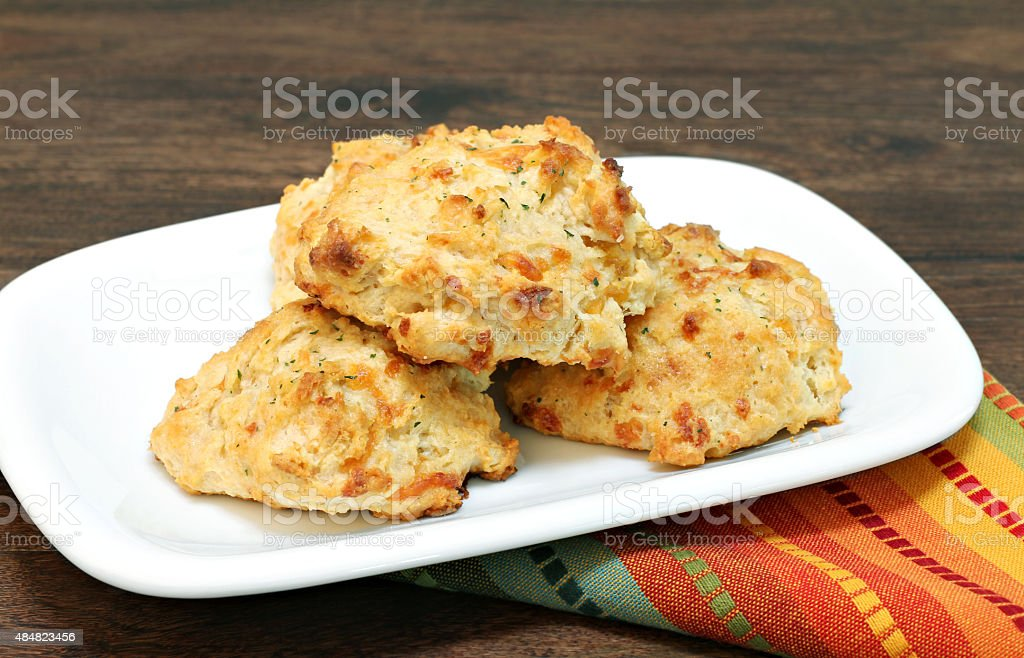 Cheddar cheese, parsley and garlic biscuits. stock photo