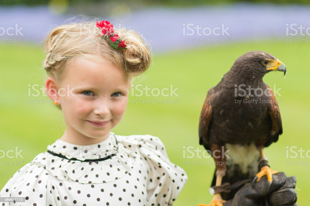 Cheecky girl with owl stock photo