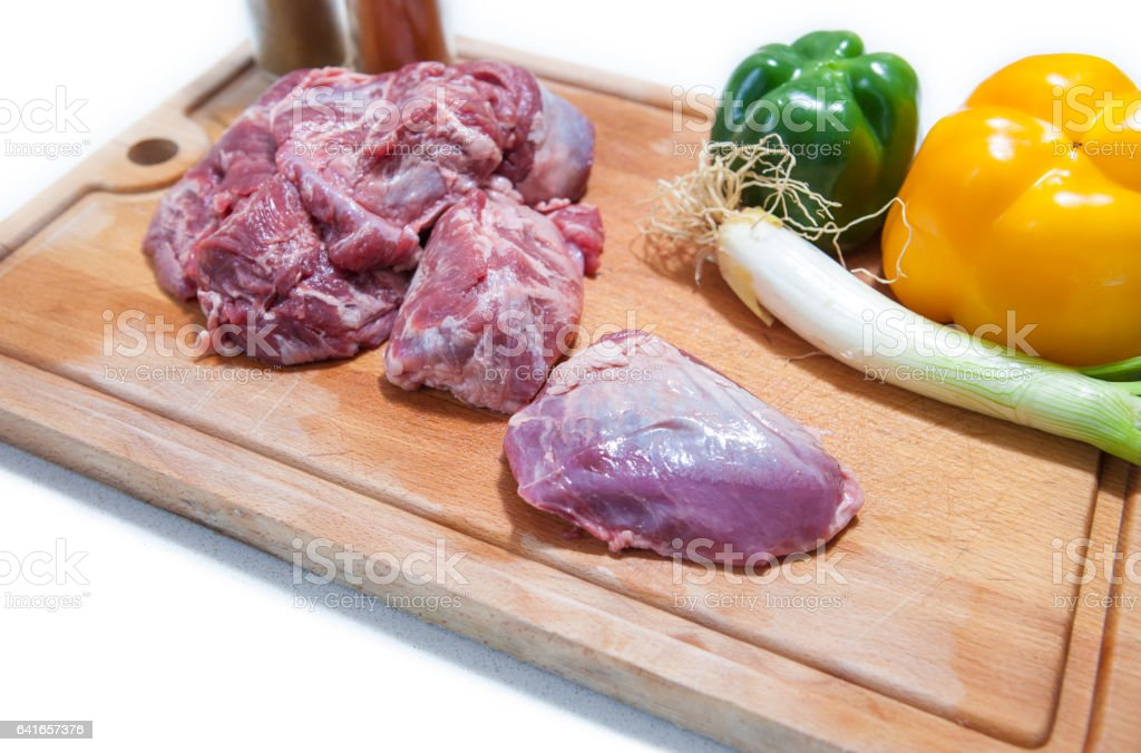 Cheek pieces of iberian pork with vegetables stock photo