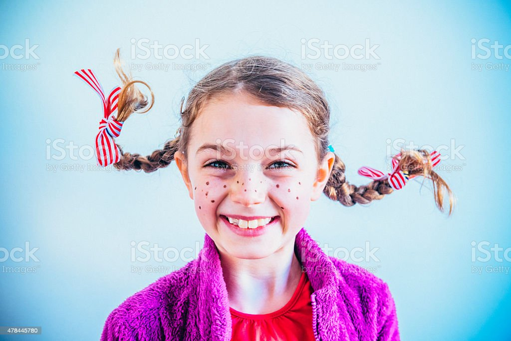 Cheeky face girl with freckles stock photo