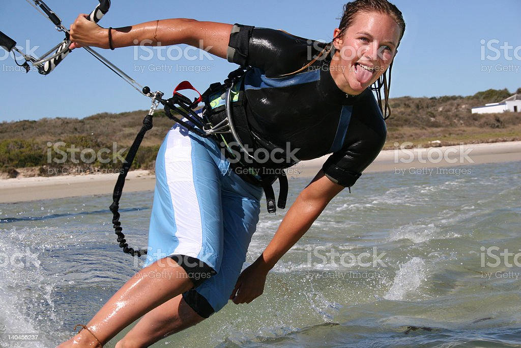 Cheeky Kitesurfing girl royalty-free stock photo
