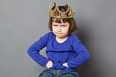 cheeky preschooler with attitude sulking with mollycoddled kid crown