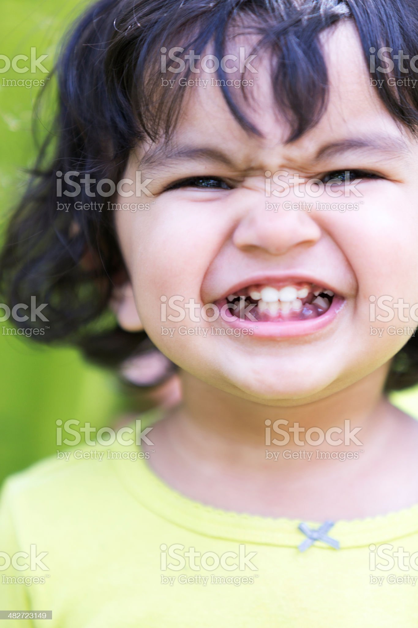 Cheeky smile from a cute baby girl royalty-free stock photo