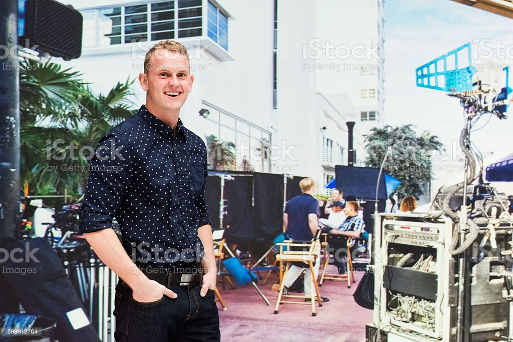 Cheerful actor standing film set stock photo