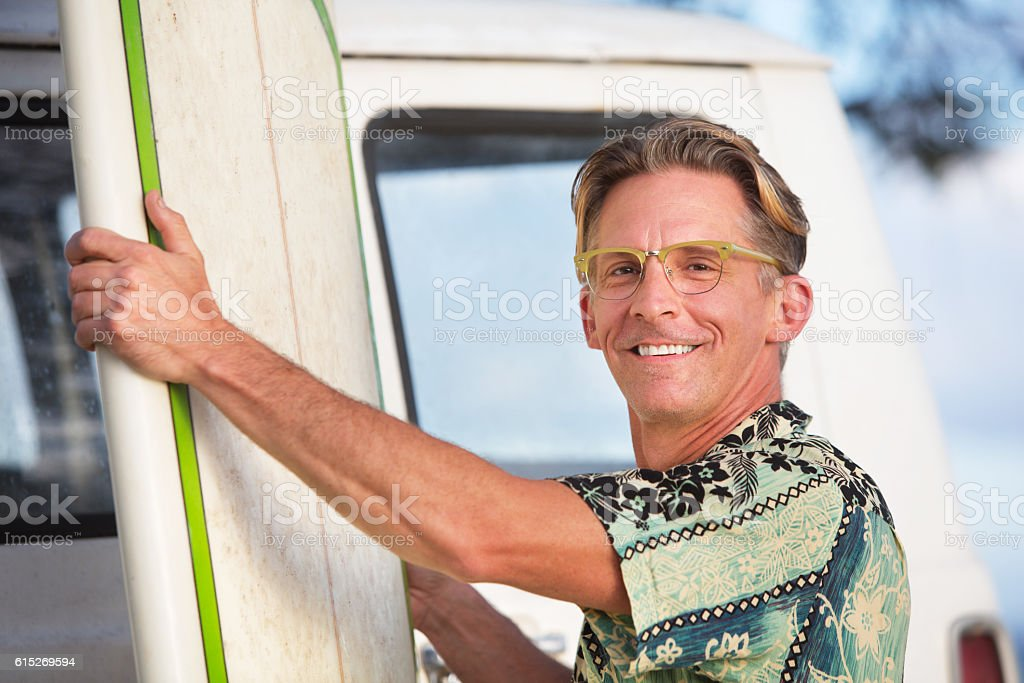 Cheerful Adult with Surfboard stock photo