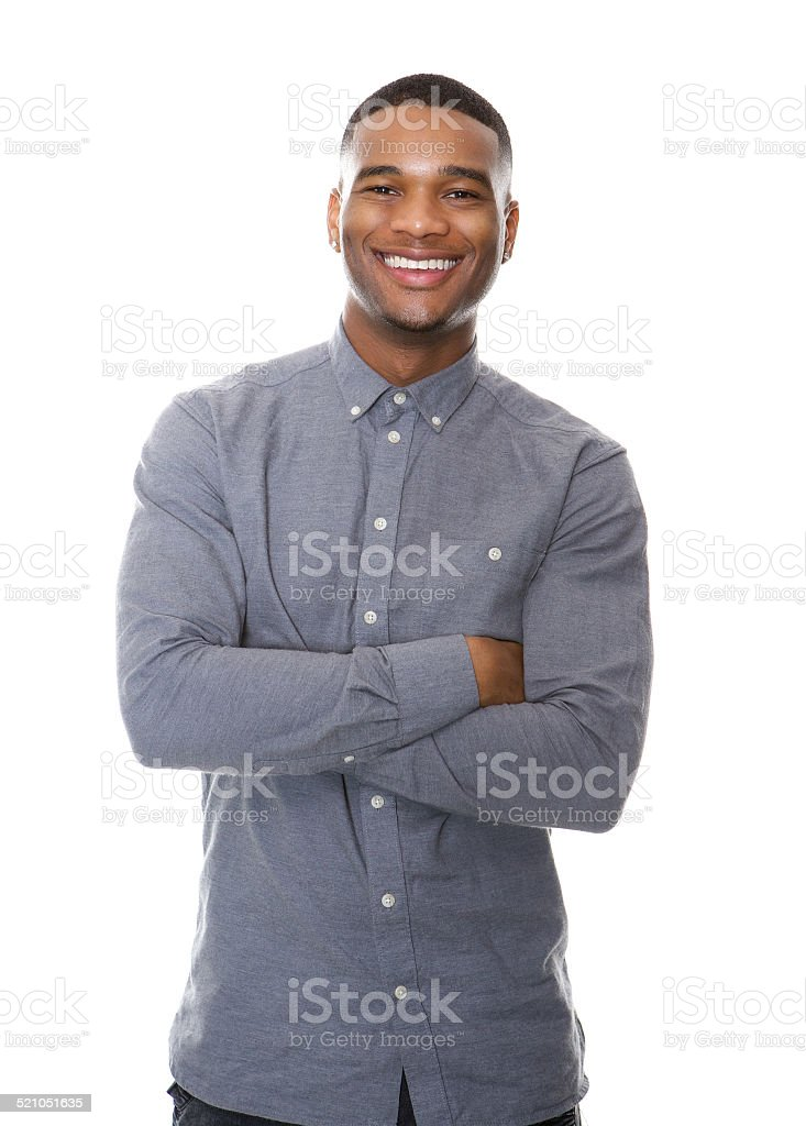 Cheerful african american man smiling with arms crossed stock photo