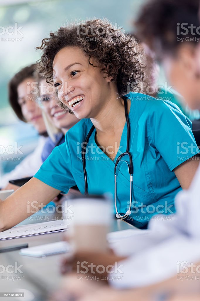 Cheerful African American nursing student smiles during class stock photo