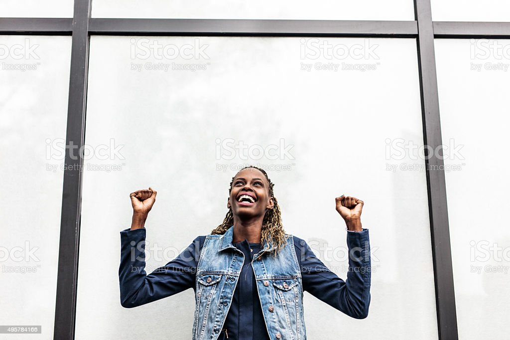 Cheerful African American woman celebrating her success. Copy space. stock photo