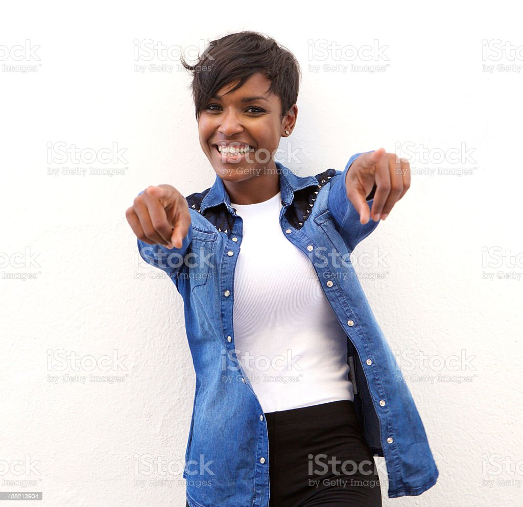 Cheerful african american woman pointing fingers stock photo