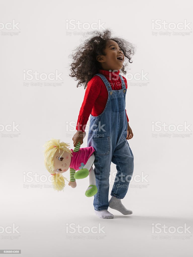Cheerful african girl with toy stock photo