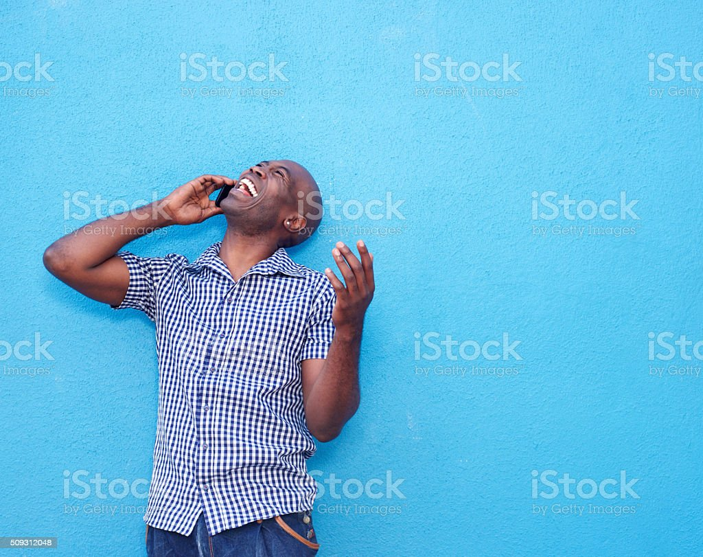 Cheerful african man talking on mobile phone stock photo