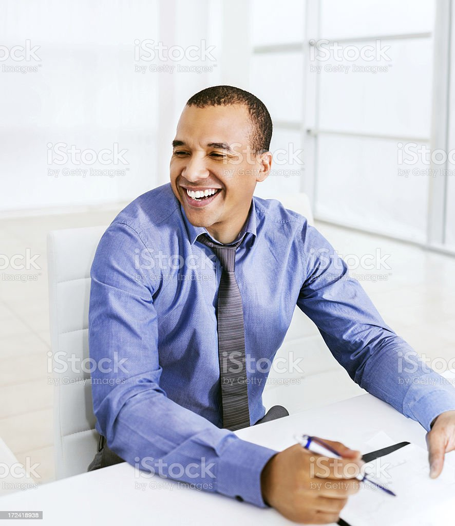 Cheerful African-American businessman at work. royalty-free stock photo