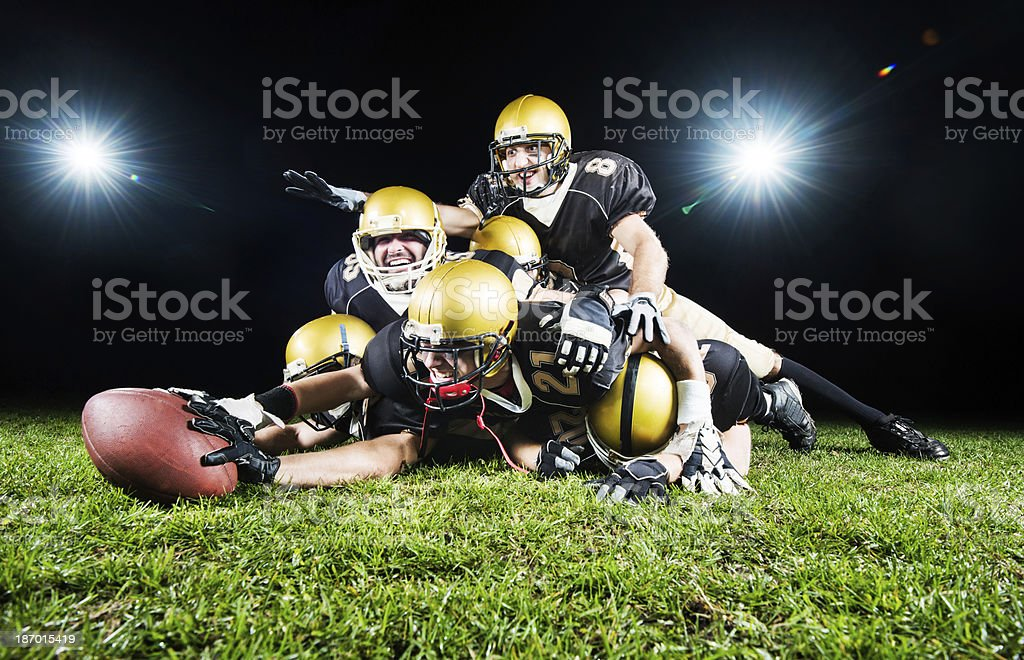 Cheerful American football team at night. royalty-free stock photo