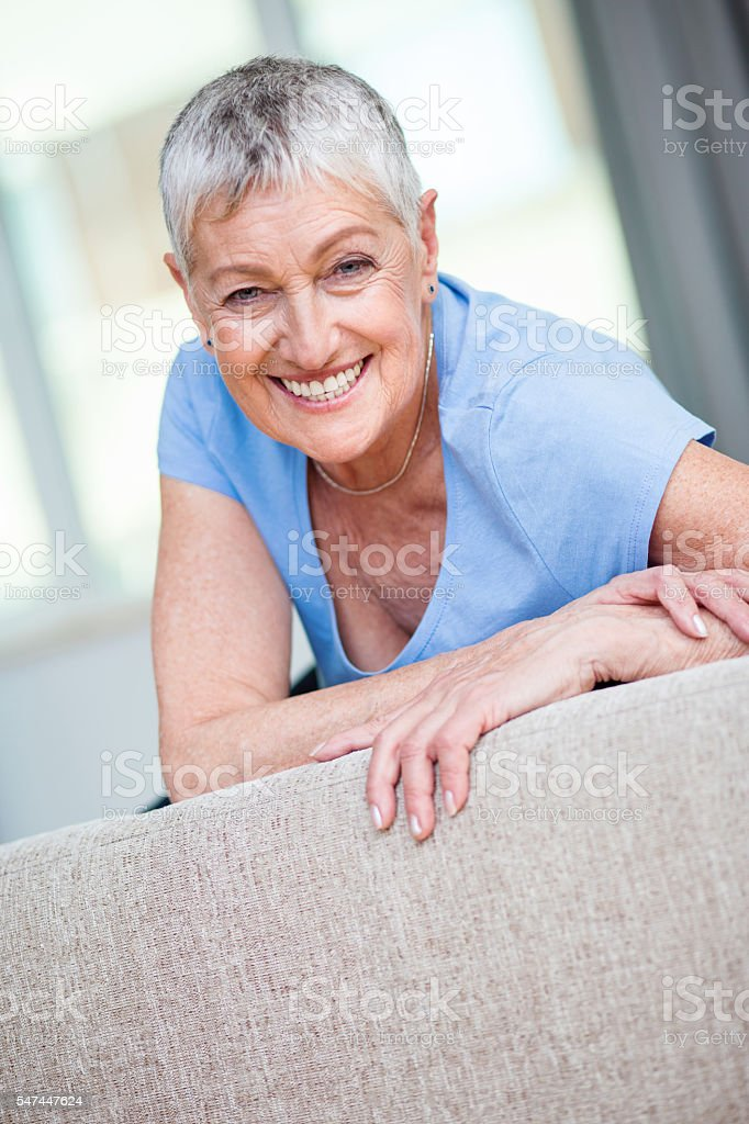 Cheerful and charming senior woman stock photo