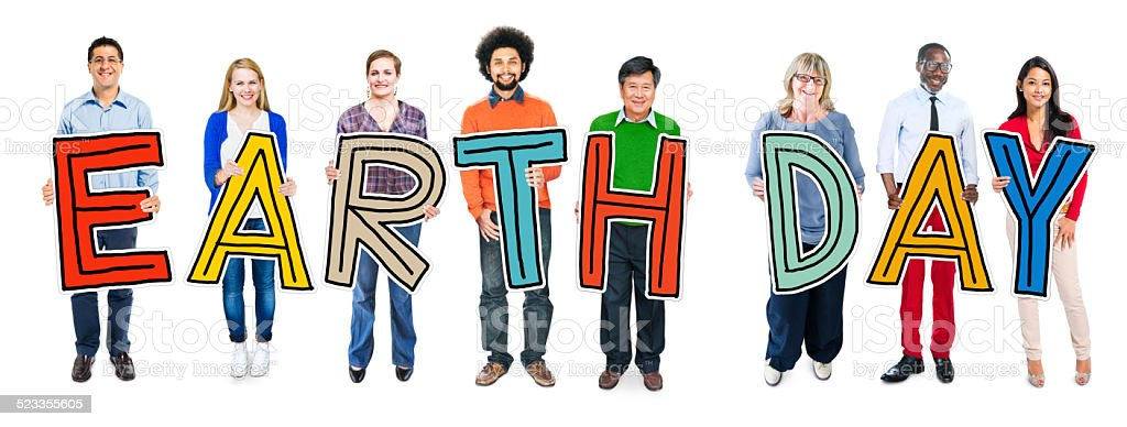 Cheerful and Diverse People Holding Text Earth Day stock photo