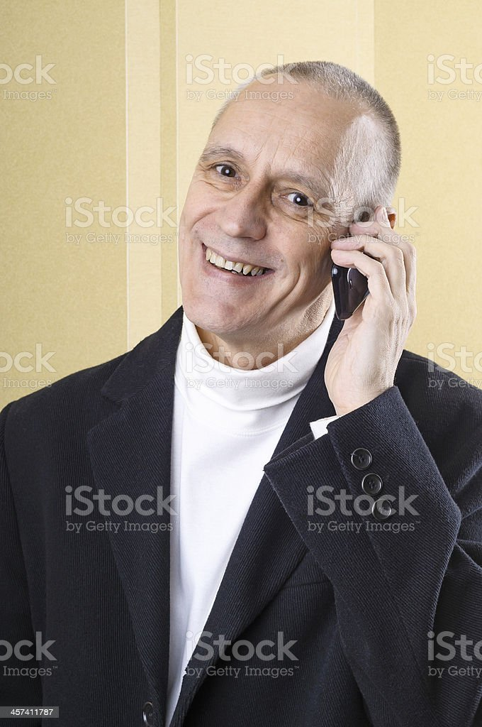 Cheerful and Smiling Man on Phone stock photo