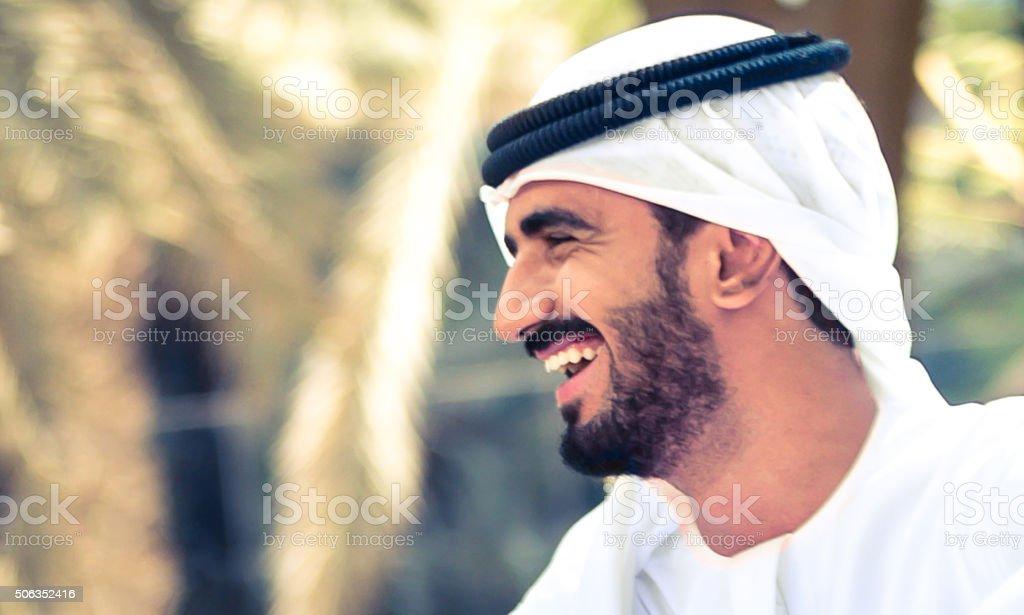 Cheerful Arab Man in a park stock photo