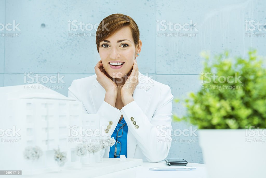 Cheerful architect smiling with satisfaction royalty-free stock photo