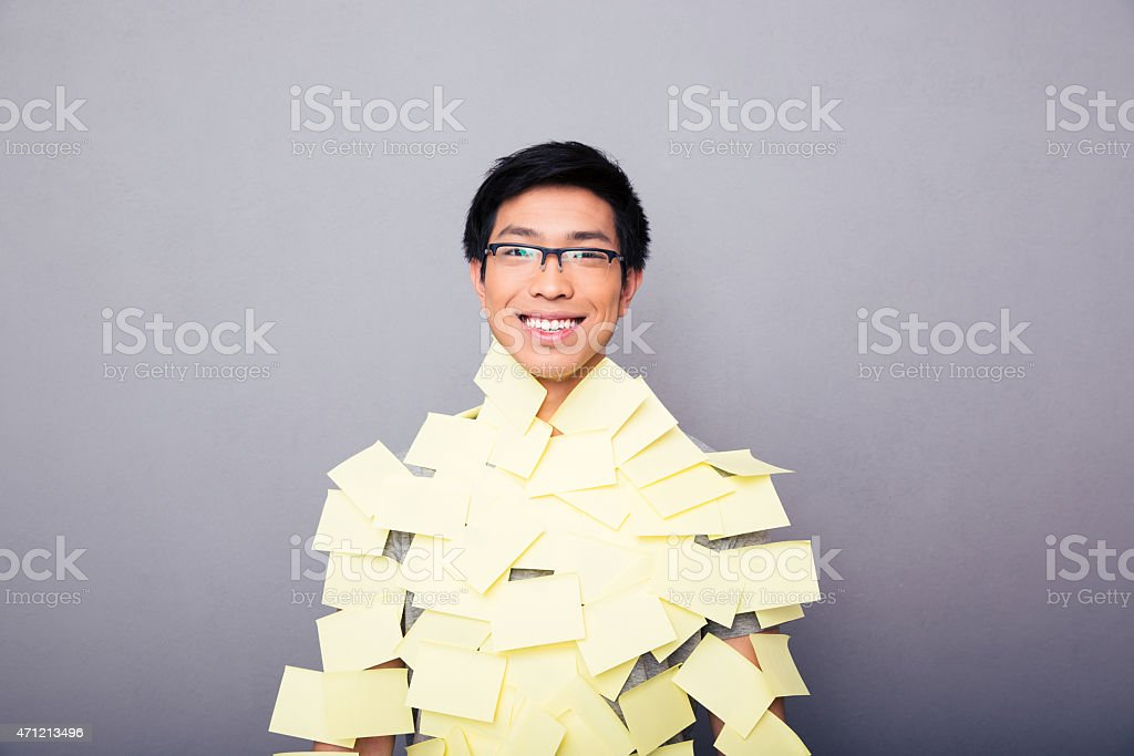 Cheerful asian man pasted stickers stock photo