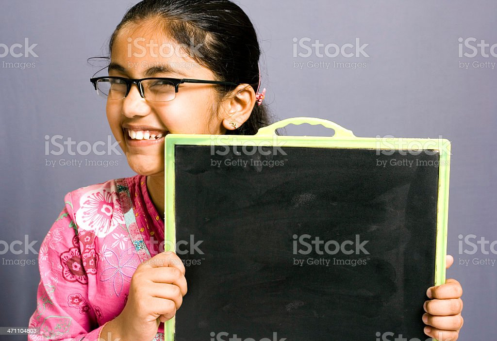 Cheerful Attractive Indian girl with a blank chalk board placard royalty-free stock photo