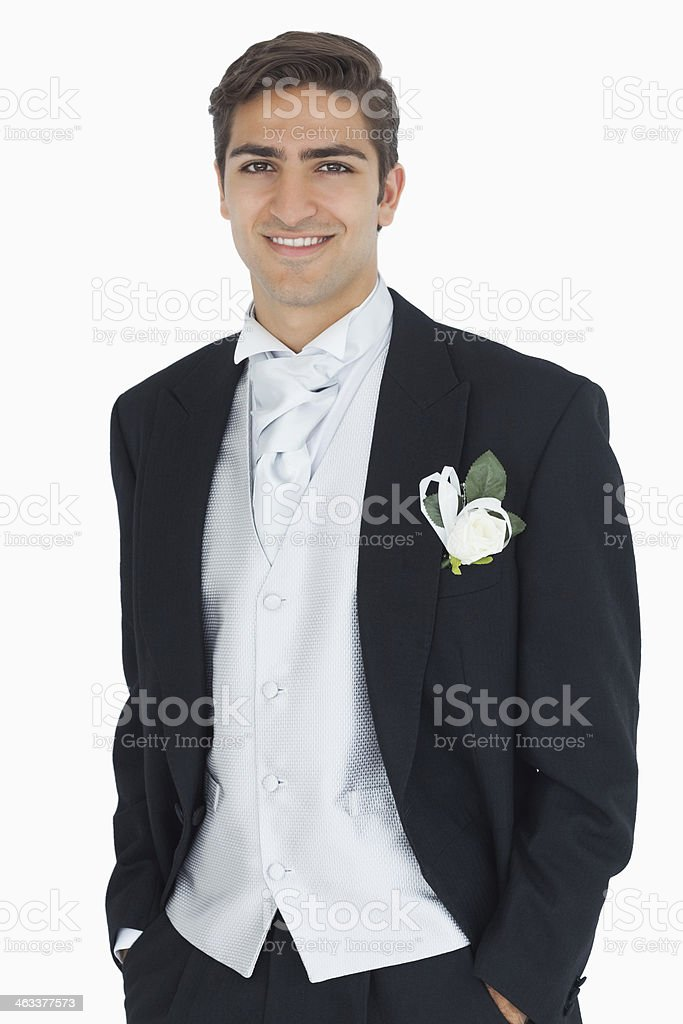 Cheerful attractive young groom looking at camera stock photo