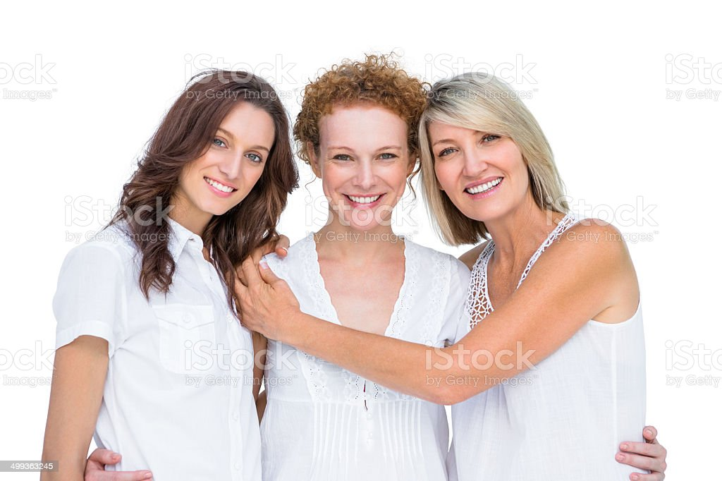 Cheerful beautiful models posing hugging each other stock photo
