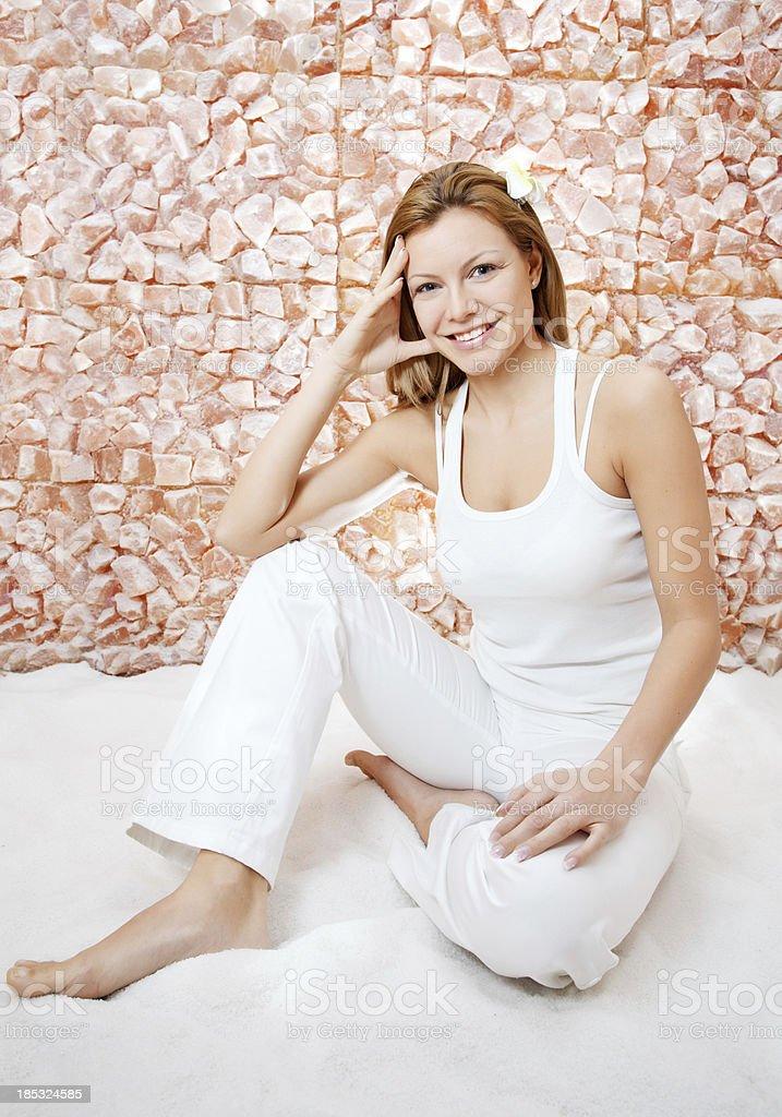 Cheerful beautiful woman in salt room. stock photo