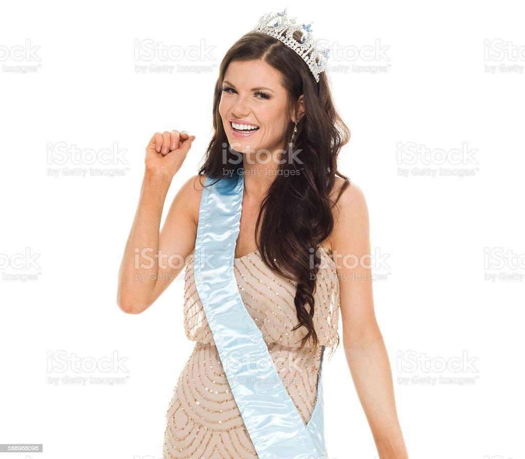 Cheerful beauty queen standing stock photo
