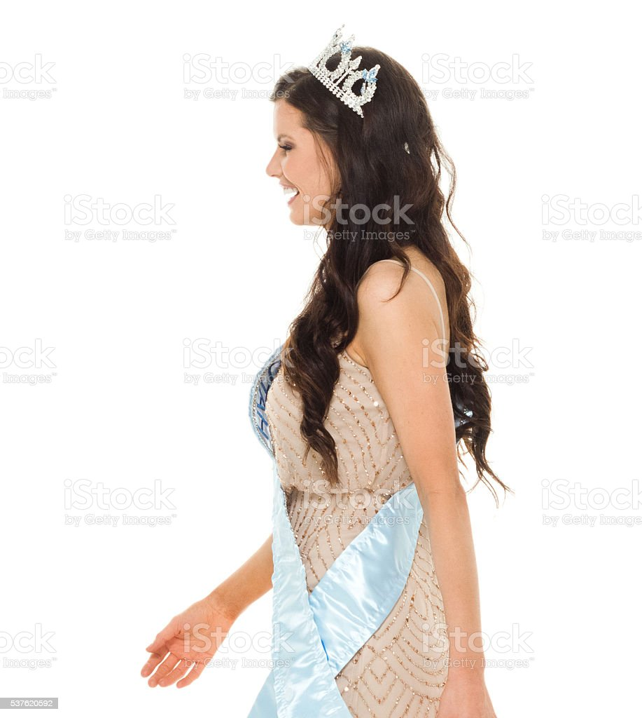 Cheerful beauty queen walking stock photo