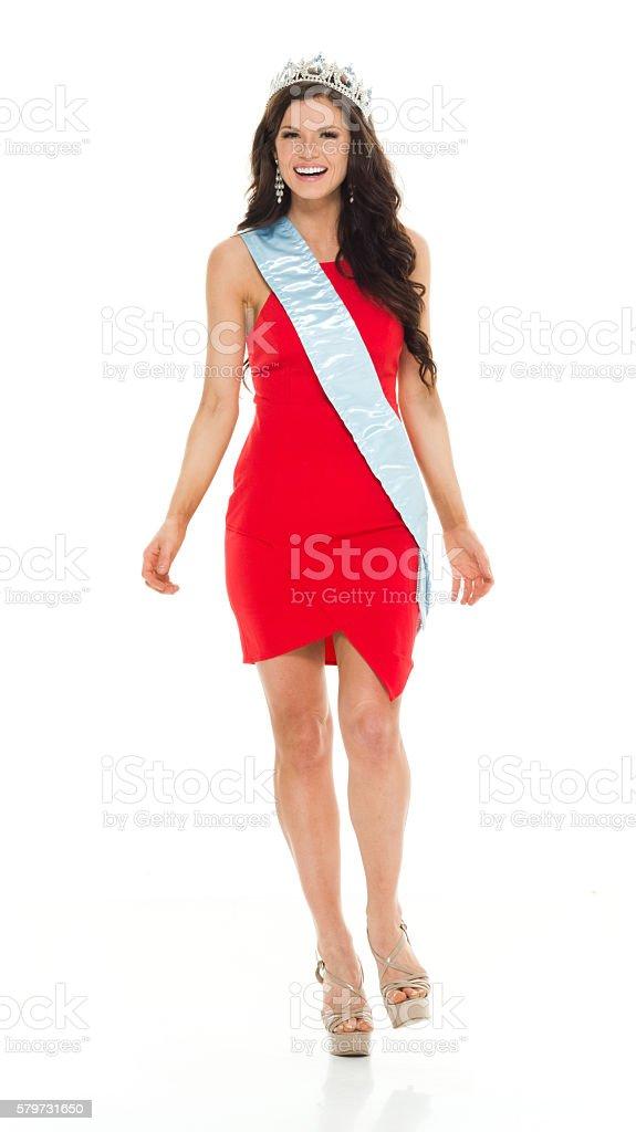 Cheerful beauty queen walking stock photo