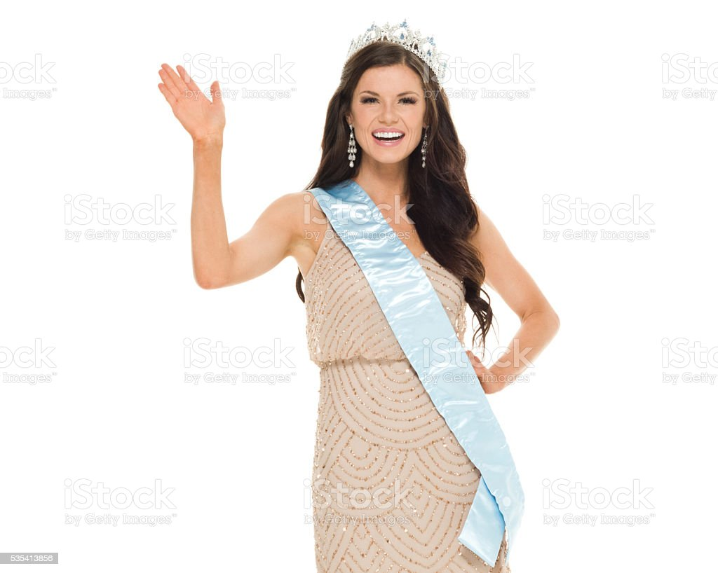 Cheerful beauty queen waving hand stock photo