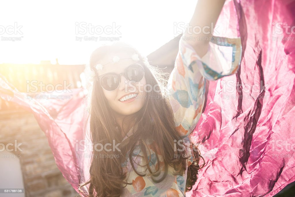 Cheerful boho woman dancing outdoor stock photo